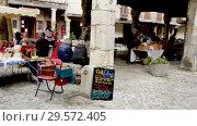 Купить «People selling handicrafts on old stone market in historical center of medieval town Lagrasse, France», видеоролик № 29572405, снято 4 октября 2018 г. (c) Яков Филимонов / Фотобанк Лори