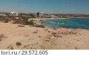 Купить «Ayia Napa, Cyprus - November 1. 2018. Rise above on Makronissos Beach», видеоролик № 29572605, снято 25 февраля 2020 г. (c) Володина Ольга / Фотобанк Лори