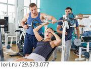 Купить «Girl injured during exercising with barbell», фото № 29573077, снято 5 ноября 2018 г. (c) Яков Филимонов / Фотобанк Лори