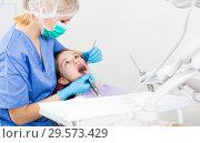 Купить «Girl getting dental treatment», фото № 29573429, снято 1 марта 2018 г. (c) Яков Филимонов / Фотобанк Лори