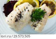 Купить «Merluccid hake fillets steamed», фото № 29573505, снято 22 августа 2019 г. (c) Яков Филимонов / Фотобанк Лори