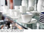 Купить «Ceramic cups in shop», фото № 29573597, снято 2 мая 2018 г. (c) Яков Филимонов / Фотобанк Лори