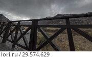 Купить «Timelapse of wooden fence on high terrace at mountain landscape with clouds. Horizontal slider movement», видеоролик № 29574629, снято 18 марта 2018 г. (c) Александр Маркин / Фотобанк Лори