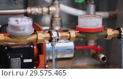 Water meters and ball valves on the domestic pipeline. Стоковое видео, видеограф Андрей Радченко / Фотобанк Лори