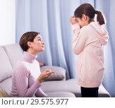 Купить «Mother reprimands her daughter», фото № 29575977, снято 26 марта 2019 г. (c) Яков Филимонов / Фотобанк Лори