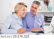 Купить «Mature employees work on documents», фото № 29576329, снято 15 января 2019 г. (c) Яков Филимонов / Фотобанк Лори