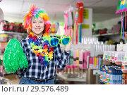 Купить «Girl in store of festival accessories», фото № 29576489, снято 15 марта 2018 г. (c) Яков Филимонов / Фотобанк Лори