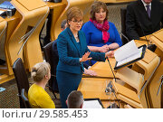 Купить «Politicians attend the Scottish First Minister's Questions at Holyrood which has just passed an alternative Brexit Bill. Featuring: Nicola Sturgeon Where...», фото № 29585453, снято 22 марта 2018 г. (c) age Fotostock / Фотобанк Лори