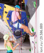 Купить «Сouple in climbing outfit training at gym», фото № 29586889, снято 18 января 2019 г. (c) Яков Филимонов / Фотобанк Лори