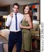 Купить «Loving couple in apartment», фото № 29586937, снято 24 сентября 2018 г. (c) Яков Филимонов / Фотобанк Лори