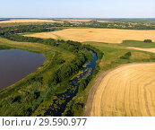 Купить «Natural landscape of central Russia with field, river and pond in August», фото № 29590977, снято 30 июля 2018 г. (c) Володина Ольга / Фотобанк Лори