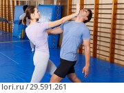 Купить «People practicing self defense techniques», фото № 29591261, снято 31 октября 2018 г. (c) Яков Филимонов / Фотобанк Лори