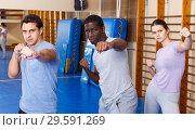 Купить «People warming up at gym», фото № 29591269, снято 31 октября 2018 г. (c) Яков Филимонов / Фотобанк Лори