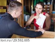 Купить «athlete discussing rental terms of outfit», фото № 29592005, снято 30 апреля 2018 г. (c) Яков Филимонов / Фотобанк Лори