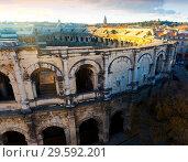 Купить «Ancient Roman amphitheater arena in Nimes, France», фото № 29592201, снято 1 декабря 2017 г. (c) Яков Филимонов / Фотобанк Лори