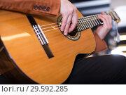 Купить «man in jacket playing an acoustic guitar», фото № 29592285, снято 29 марта 2017 г. (c) Яков Филимонов / Фотобанк Лори