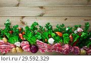 Купить «Raw mutton and vegetables assortment on natural wooden background», фото № 29592329, снято 5 июля 2020 г. (c) Яков Филимонов / Фотобанк Лори
