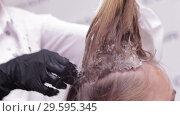 Купить «Close up - Hands of Hair Stylist Doing Hairparting for a Woman in a Beauty Salon», видеоролик № 29595345, снято 8 октября 2018 г. (c) Pavel Biryukov / Фотобанк Лори