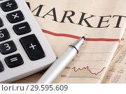 Купить «Калькулятор и карандаш на газете с финансовыми новостями», фото № 29595609, снято 23 января 2010 г. (c) Александр Гаценко / Фотобанк Лори
