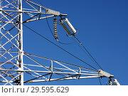 Купить «Опора ЛЭП с высоковольтными проводами на фоне голубого неба», фото № 29595629, снято 30 января 2010 г. (c) Александр Гаценко / Фотобанк Лори