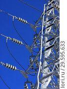 Купить «Опора ЛЭП с высоковольтными проводами на фоне голубого неба», фото № 29595633, снято 30 января 2010 г. (c) Александр Гаценко / Фотобанк Лори