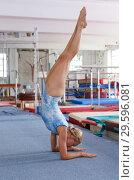 Купить «Sporty female gymnast in bodysuit during workout in sport gym», фото № 29596081, снято 18 июля 2018 г. (c) Яков Филимонов / Фотобанк Лори