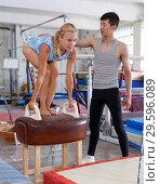 Купить «Man and woman training on pommel horse», фото № 29596089, снято 18 июля 2018 г. (c) Яков Филимонов / Фотобанк Лори