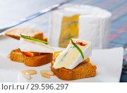 Купить «Canape with orange and blue cheese», фото № 29596297, снято 22 марта 2019 г. (c) Яков Филимонов / Фотобанк Лори