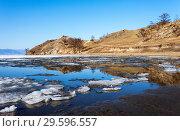 Купить «Spring sunny day on the shore of Lake Baikal. Ice floes are melting on the shores of the Kurkutsky Bay of the Small Sea», фото № 29596557, снято 9 мая 2013 г. (c) Виктория Катьянова / Фотобанк Лори