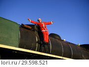 Купить «Man in Santa outfit on old locomotive», фото № 29598521, снято 19 декабря 2017 г. (c) age Fotostock / Фотобанк Лори