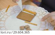 Купить «Family traditions. Decoration gingerbread house. Preparing for the holiday of Christmas», видеоролик № 29604365, снято 27 июня 2019 г. (c) Константин Мерцалов / Фотобанк Лори