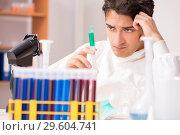 Купить «The young biochemist working in the lab», фото № 29604741, снято 11 августа 2018 г. (c) Elnur / Фотобанк Лори