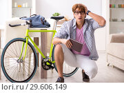 Купить «The student commuting to university using cycle», фото № 29606149, снято 30 августа 2018 г. (c) Elnur / Фотобанк Лори