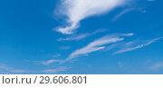 Купить «Blue sky with windy cirrus clouds at daytime», фото № 29606801, снято 6 сентября 2018 г. (c) EugeneSergeev / Фотобанк Лори