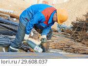 Купить «worker cutting rebar by grinding machine», фото № 29608037, снято 8 октября 2014 г. (c) Дмитрий Калиновский / Фотобанк Лори