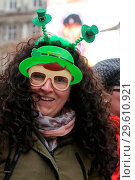 Купить «Performers take part in the annual St. Patrick's Day Parade in central London, as tens of thousands of people watch the parade. Saint Patrick's Day, or...», фото № 29610921, снято 18 марта 2018 г. (c) age Fotostock / Фотобанк Лори