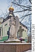 Купить «Скульптура ангела на фоне часовни Ксении Блаженной на Смоленском кладбище. Санкт-Петербург», фото № 29618261, снято 17 декабря 2018 г. (c) Сергей Афанасьев / Фотобанк Лори