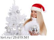 Купить «Young woman in Santa Claus cap», фото № 29619561, снято 22 октября 2013 г. (c) Мельников Дмитрий / Фотобанк Лори