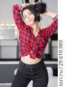 Купить «Charming woman dressed a plaid shirt.», фото № 29619989, снято 8 января 2016 г. (c) Сергей Сухоруков / Фотобанк Лори