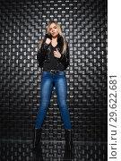 Купить «Beautiful woman posing in the studio», фото № 29622681, снято 22 февраля 2016 г. (c) Сергей Сухоруков / Фотобанк Лори