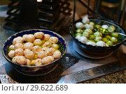 Купить «Different hummus in the form of balls in olive oil», фото № 29622689, снято 6 апреля 2018 г. (c) Володина Ольга / Фотобанк Лори