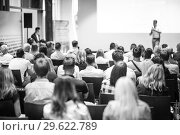 Купить «Business speaker giving a talk at business conference event.», фото № 29622789, снято 15 июня 2018 г. (c) Matej Kastelic / Фотобанк Лори