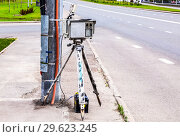 Купить «Traffic enforcement camera and vehicles in motion on city street», фото № 29623245, снято 12 июня 2018 г. (c) FotograFF / Фотобанк Лори