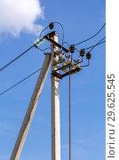 Купить «High voltage electricity pylon with wires against the blue sky», фото № 29625545, снято 2 сентября 2018 г. (c) FotograFF / Фотобанк Лори