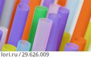 Купить «Top view of colorful straw on the rotation table», видеоролик № 29626009, снято 23 июля 2019 г. (c) Dzmitry Astapkovich / Фотобанк Лори