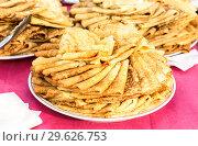 Купить «Appetizing fried pancakes on the Pancake Week», фото № 29626753, снято 18 февраля 2018 г. (c) FotograFF / Фотобанк Лори