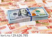 Купить «American dollars banknotes over russian roubles», фото № 29626785, снято 4 января 2017 г. (c) FotograFF / Фотобанк Лори
