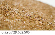 Купить «Pile of flax seeds on rotating table, macro view, healthy food», видеоролик № 29632505, снято 9 июля 2020 г. (c) Dzmitry Astapkovich / Фотобанк Лори
