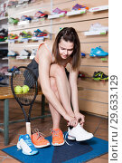Woman trying professional sneakers in sport store. Стоковое фото, фотограф Яков Филимонов / Фотобанк Лори