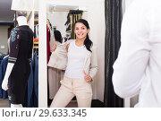 Купить «Happy couple purchasing jacket», фото № 29633345, снято 24 октября 2016 г. (c) Яков Филимонов / Фотобанк Лори
